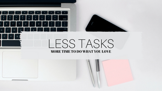 Laptop, phone, pink postits and pens 'Less Tasks, More time to do what you love'