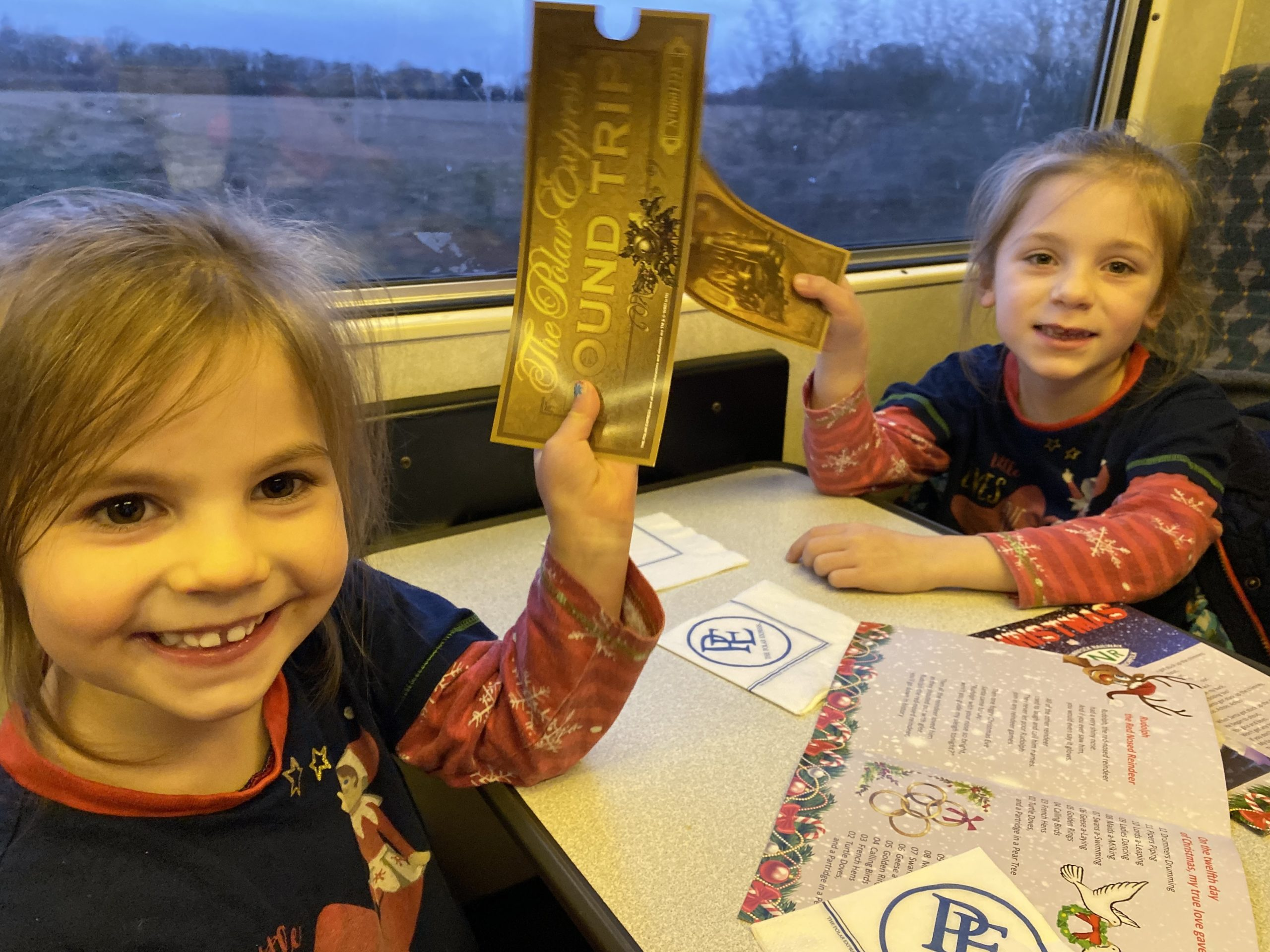 Girls holding their tickets on the polar express
