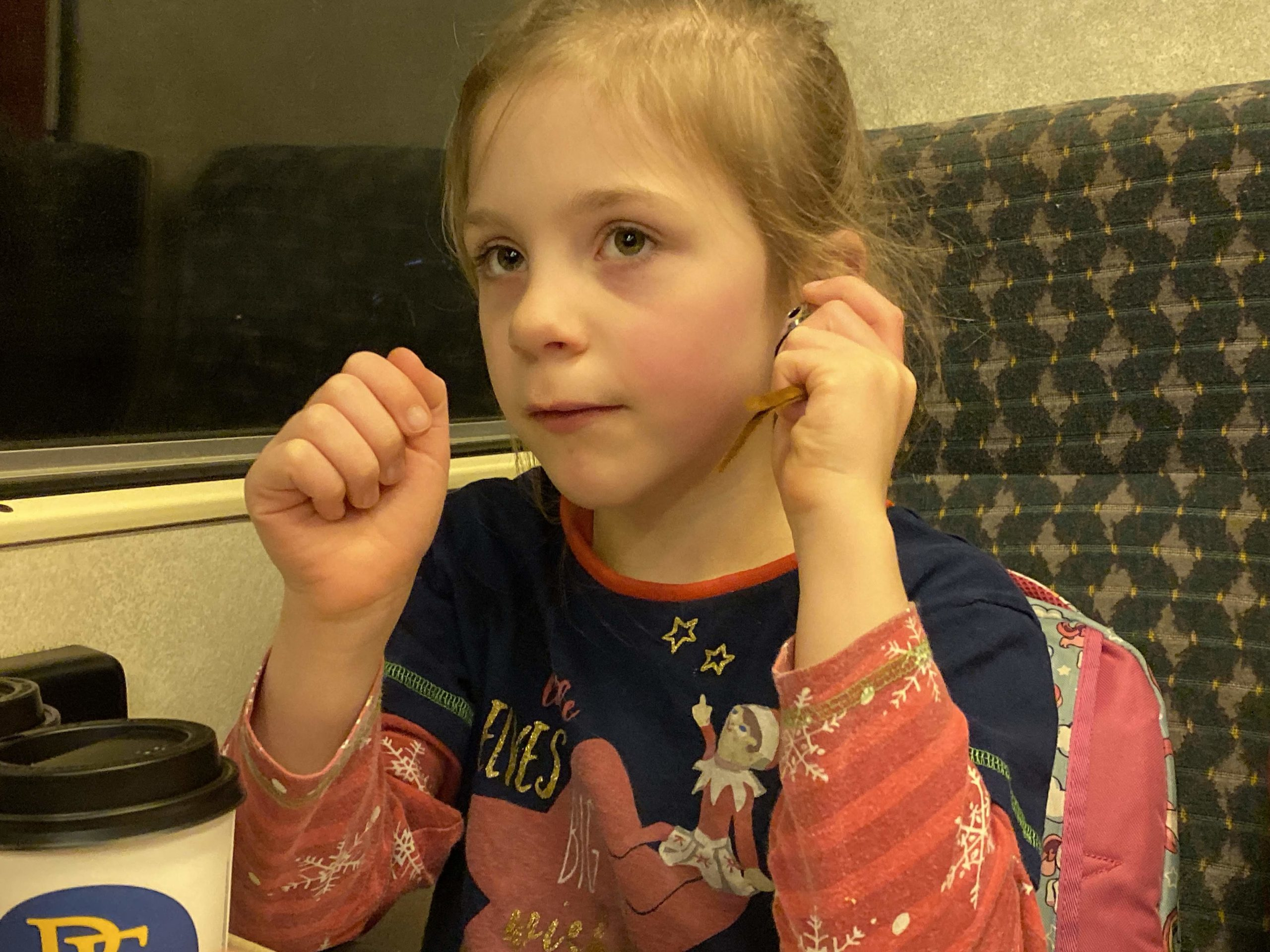 Girl listening to her bell on the polar express
