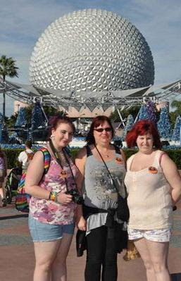 Planing a Walt Disney World Holiday. 3 adults stand in EPCOT at Walt Disney World. Surrounded by Christmas decor.